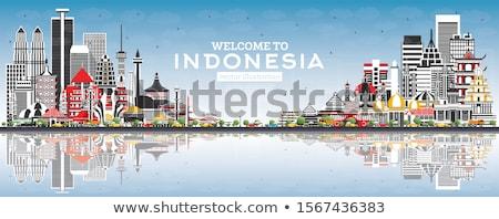 Jakarta skyline grijs blauwe hemel toerisme Stockfoto © ShustrikS