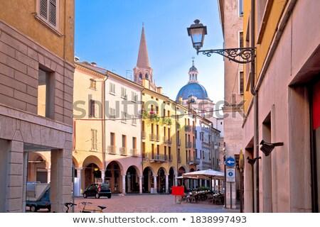 Mantova city street sun haze view, UNESCO world heritage site Stock photo © xbrchx