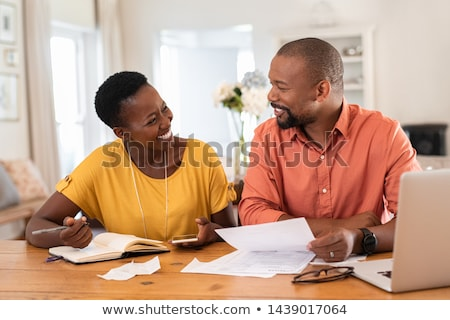 African Couple Calculating Savings Budget Stock photo © AndreyPopov