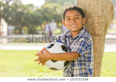 Mixed Race Hispanic and African American Boy Holding Soccer Ball Stock photo © feverpitch