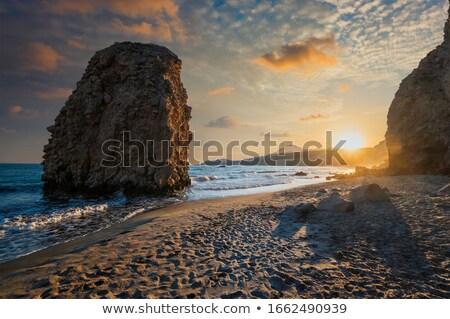 Praia pôr do sol ilha Grécia ondas mar Foto stock © dmitry_rukhlenko