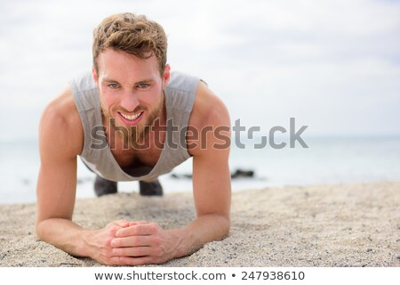 Crossfit training fitness man doing plank core exercise working out his midsection core muscles. Fit Stock photo © Maridav