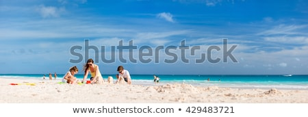 Mother with children playing with sand on beach Stock photo © Paha_L