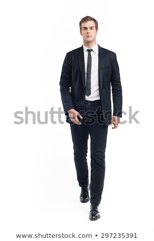 mature businesman walking towards stock photo © rtimages