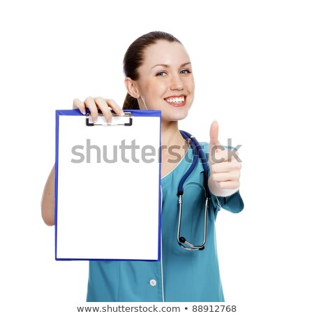 Stock photo: pretty nurse showing clipboard with white paper sheet