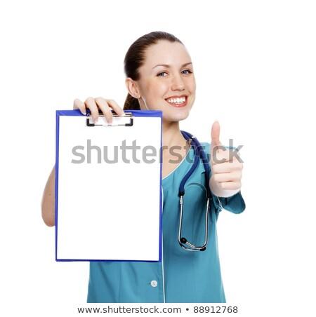 mooie · verpleegkundige · tonen · witte · papier - stockfoto © Nobilior