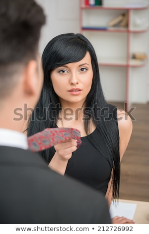 Woman pulling tie Stock photo © photography33