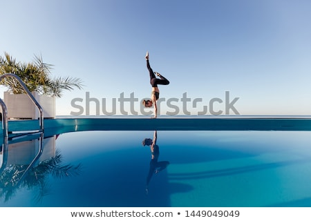 yoga pinch mayurasana pose Stock photo © zastavkin