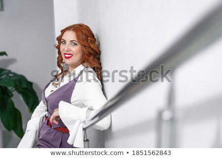 stylish young woman leans her elbows stock photo © mtoome