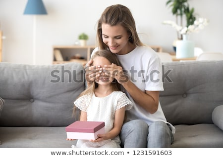 little girl receiving birthday present stock photo © photography33