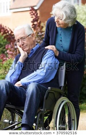 Man rolstoel vrouw arts geneeskunde verpleegkundige Stockfoto © photography33