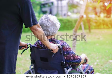 Old lady in wheelchair Stock photo © photography33