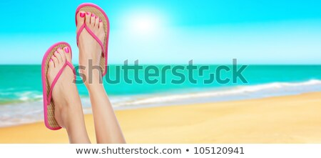 Pink sandals on woman legs. Summer time concept Stock photo © Nobilior