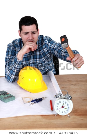 Engineer hitting an alarm clock with a hammer Stock photo © photography33