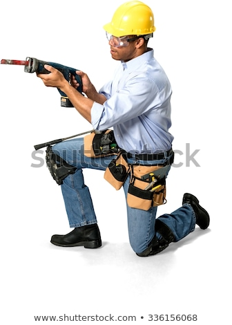 Man kneeling with drill Stock photo © photography33