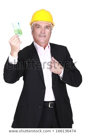 Businessman in a hardhat holding a 100 euro note Stock photo © photography33