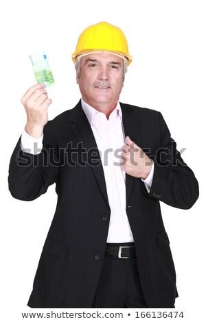 üzletember munkavédelmi sisak tart 100 Euro jegyzet Stock fotó © photography33