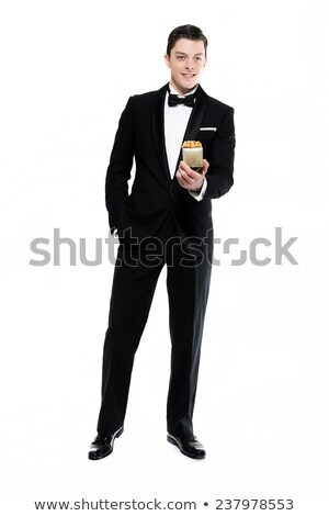 Man in black dinner jacket with bow tie Stock photo © Photoline
