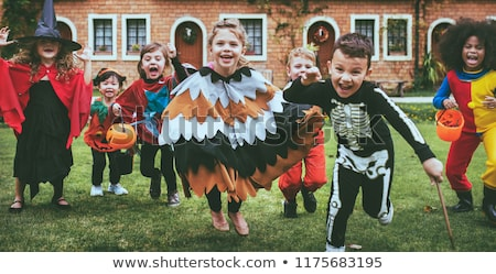 Boy and girl wearing halloween costume Stock photo © stockyimages