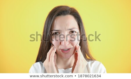 Portrait of an unhappy patient against white background Stock photo © wavebreak_media