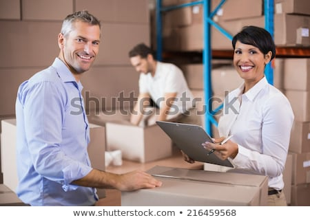Young man taping shut a cardboard box Stock photo © photography33