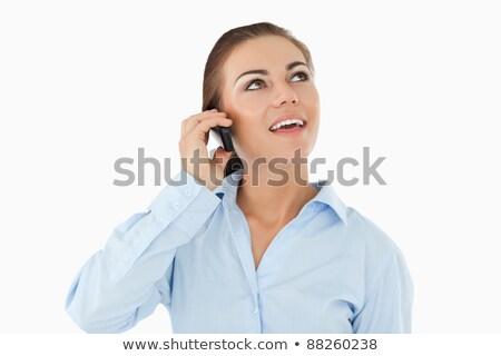 sorridente · empresária · olhando · telefone · branco · negócio - foto stock © wavebreak_media