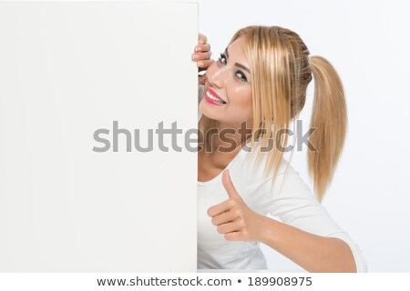 woman looking amazed at cards Stock photo © feedough