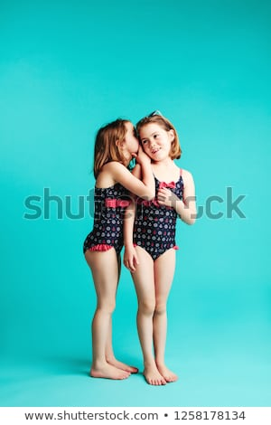 The girl shares the secrets of her friend  Stock photo © dacasdo