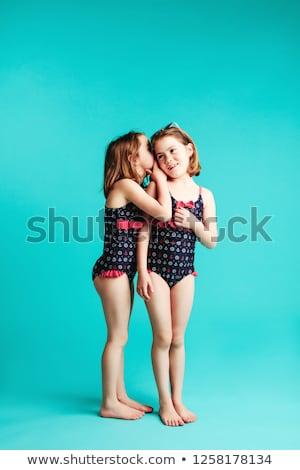 The girl shares the secrets of her friend  Stock photo © dacasdo
