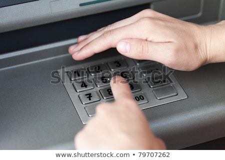 Menselijke hand atm bancaire cash machine Stockfoto © dacasdo