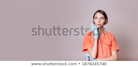 contemplating young woman medical doctor Stock photo © stepstock