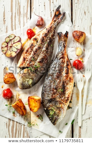 sea bream fish grilling on bbq stock photo © kuzeytac