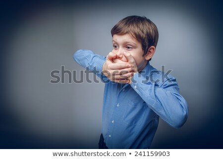 boy with a closed mouth stock photo © peredniankina