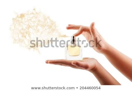 Woman spraying perfume Stock photo © dash