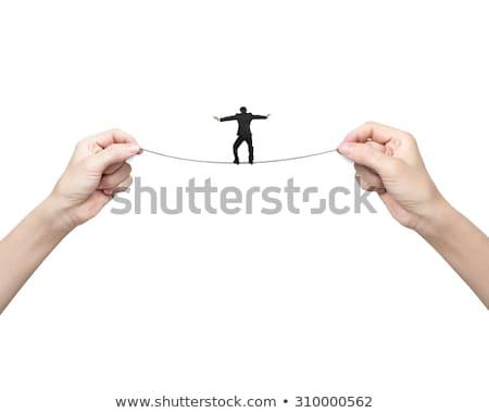 Businessman holding tight to a rope Stock photo © stevanovicigor