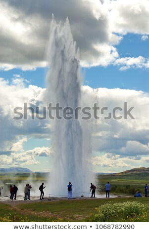 Geysir Strokkur erupting with people Stock photo © Hofmeester