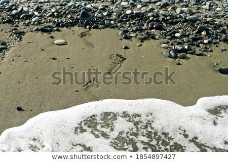 Foto stock: Par · pegadas · molhado · areia · água