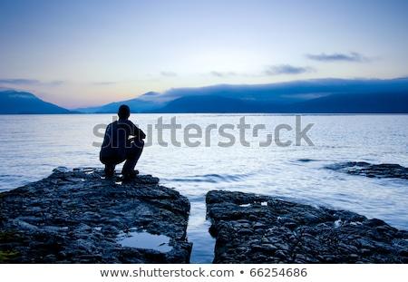 Foto stock: Ombre · sentado · en · la · pequeña · isla