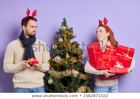 Young couple kissing and offended girl standing on a background  Stock photo © Nejron