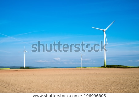 Barren field and windwheels Stock photo © elxeneize