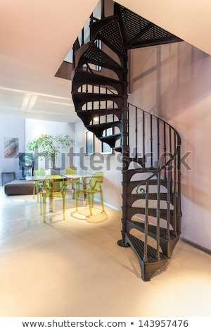 Vintage metal dark spiral staircase Stock photo © nalinratphi