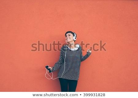 Beautiful carefree woman listening to music Stock photo © dash