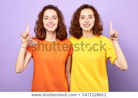 zorgeloos · tweelingen · portret · gelukkig · meisje · lopen · beneden - stockfoto © rosshelen