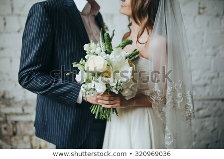 Bride and groom holding hands on wood background Stock photo © sfinks