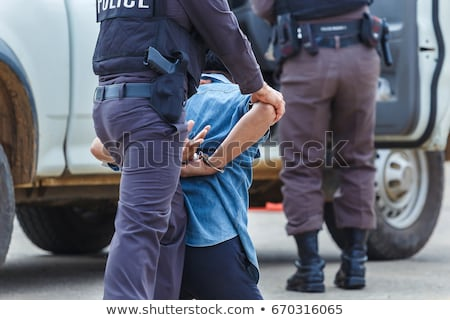 woman police with handcuffs on white stock photo © elnur