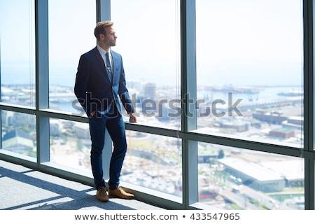 thoughtful businessman looking away on the floor stock photo © wavebreak_media