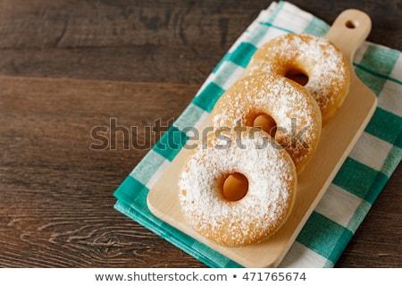 Sweet sugary donuts on rustic table Stock photo © stevanovicigor