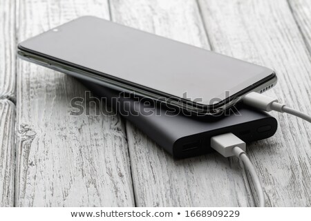 charging a smartphone with powerbank on white stock photo © adamr