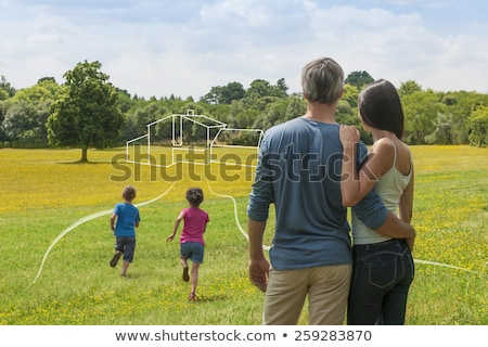 Stock photo: family of four running in dream house