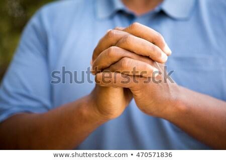 Foto stock: Folded Hands Of Christian Man Praying